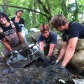 Vans Warped Tour volunteers remove a shopping cart from Gwynns Falls